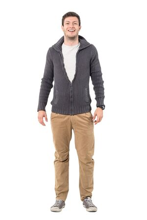 Young relaxed casual man in sweater laughing at camera. Full body length portrait isolated over white background.