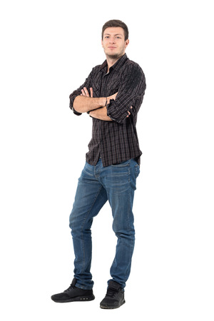 Smiling handsome man with rolled up shirt sleeves with crossed arms. Full body length portrait isolated over white background.