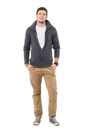 Smiling young casual man in autumn clothes looking at camera. Full body length portrait isolated over white background.