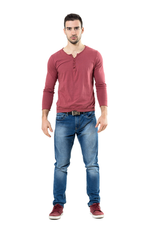 Upset serious trendy casual man with intense stare at camera.  Full body length portrait isolated over white background.