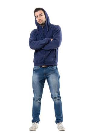 Cool young confident man in blue sweatshirt with crossed arms looking at camera. Full body length portrait isolated over white studio background. Stock Photo - 76848076