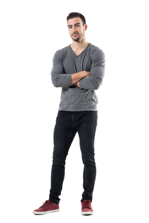 Successful young handsome casual man with crossed arms smiling. Full body length portrait isolated over white studio background.