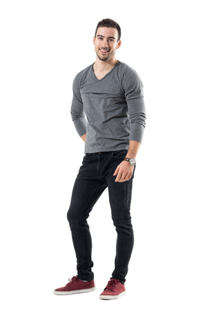 Cool young relaxed man laughing and looking at camera. Full body length portrait isolated over white studio background. Stockfoto
