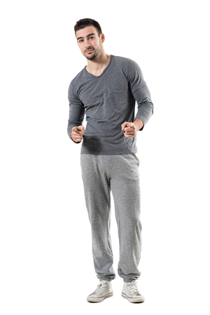 Happy young fit sporty athletic man pointing finger choosing you. Full body length portrait isolated on white studio background.