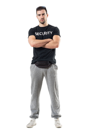 Tough macho bouncer wearing waist bag with crossed arms looking at camera. Full body length portrait isolated on white studio background.