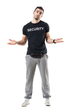 Confused uncertain bouncer or plainclothes officer shrugging shoulders. Full body length portrait isolated on white studio background. Stock Photo