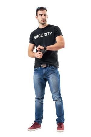 Plain clothes police officer cocking gun.  Full body length  portrait isolated on white studio background.