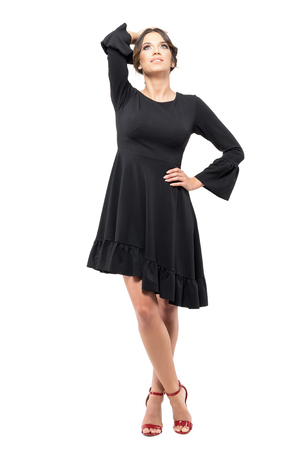 Standing Classy Formal Woman In Black Dress With Hand Clasped ...