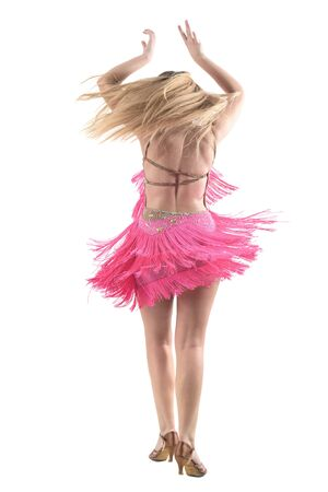 Back view of latino blonde dancer spinning motion with arms raised up above head. Full body length portrait isolated on white studio background.