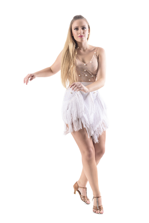 Young attractive blonde caucasian woman dancing latino dances looking at camera. Full body length portrait isolated on white studio background.  Stock Photo