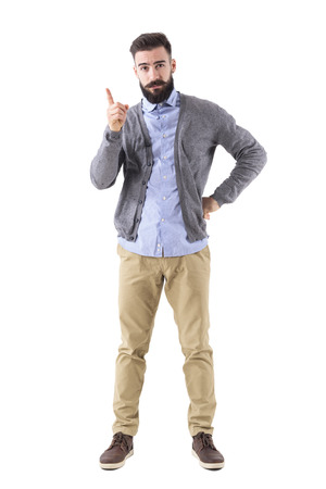 Strict bossy businessman or teacher scolding finger and looking at camera. Full body length portrait isolated on white studio background. Stock Photo