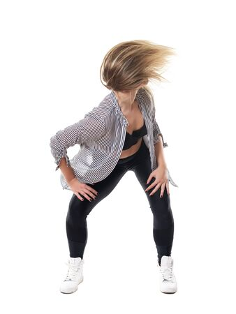 Action flowing hair motion of energetic dance hall woman aerobics instructor. Full body length portrait isolated on white studio background.