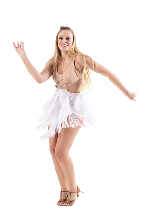 Smiling happy professional caucasian woman dancing latino dances. Full body length portrait isolated on white studio background.