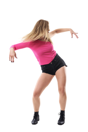 Action movement of female jazz dancer with flowing blonde hair toss. Full body length portrait isolated on white studio background.