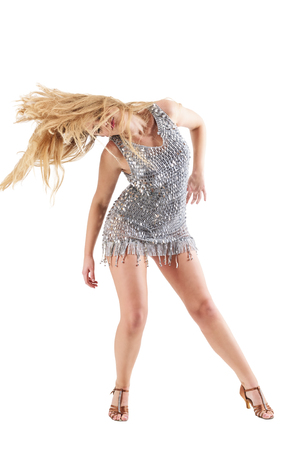 Passionate woman dancing and swinging head with flowing long moving hair. Full body length portrait isolated on white studio background.