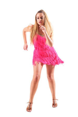 Passionate expressive excited blonde woman dancing wearing pink dress in action. Full body isolated on white background.