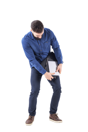 Business man carrying multiple objects holding from dropping down. Multitask overwork concept. Full body isolated on white background.