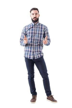 Bearded business man in plaid shirt pointing with amused expression looking at camera. Full body isolated on white background.