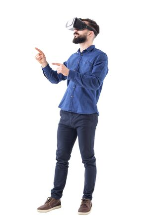 Side view of bearded business man gesticulating with hand and finger having virtual reality experience. Full body isolated on white background.