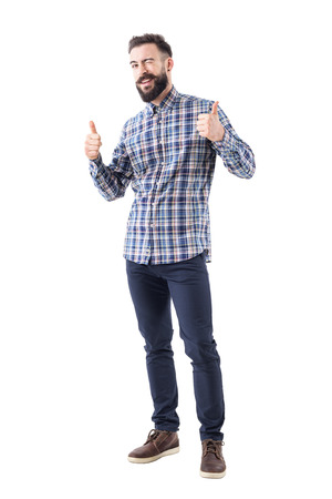 Bearded young adult business man in checked shirt with thumbs up smile and wink at camera. Full body isolated on white background.