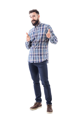 Confident cool friendly bearded guy pointing finger at camera and biting lips. Full body isolated on white background.