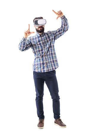 Young bearded adult business man wearing vr-glasses with zooming or resizing augmented screen gesture. Full body isolated on white background. Stok Fotoğraf - 102702435