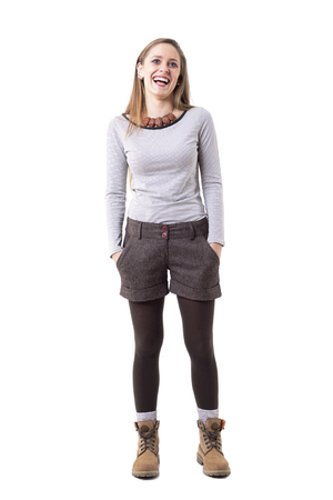 Candid happy relaxed stylish hipster girl in second hand clothes laughing. Full body isolated on white background. Foto de archivo