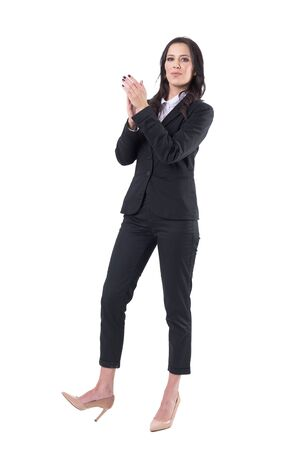 Pretty elegant business woman in suit applauding and admiring looking at camera. Full body isolated on white background. Stockfoto - 133451238