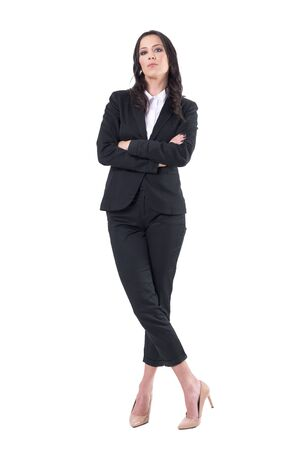 Frustrated annoyed pretty business woman ceo with crossed arms looking at camera authoritative. Full body isolated on white background.