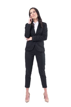 Mindful attentive corporate woman in business suit looking up interested during presentation. Full body isolated on white background.