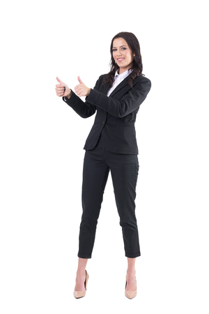 Happy smiling elegant pretty business woman showing thumbs up with both hands and looking at camera. Full body isolated on white background. Stock Photo