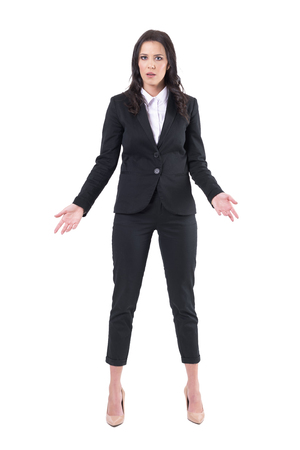 Misunderstanding concept. Annoyed business woman with open arms looking at camera. Full body isolated on white background. Banque d'images