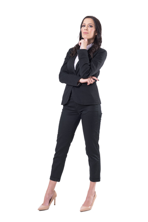 Elegant beautiful caucasian business woman in suit posing with finger under chin. Full body isolated on white background.