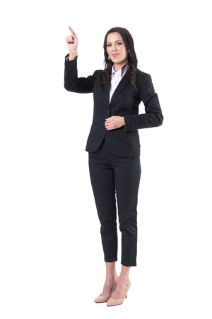 Young happy beautiful elegant business woman in formal suit pointing finger up. Full body isolated on white background.