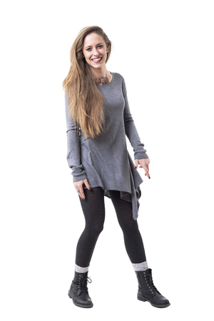 Playful carefree young long hair blonde woman laughing and looking at camera. Full body isolated on white background.