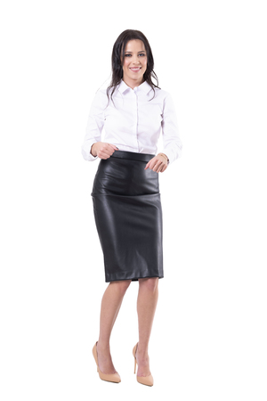 Joyful happy beautiful business woman dancing and smiling looking at camera. Full body isolated on white background.