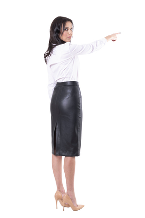Angry serious strict authoritative teacher or business woman boss with get lost finger gesture. Full body isolated on white background.