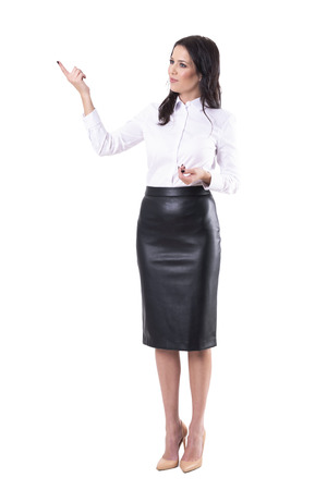 Young adult beautiful business woman pointing finger showing and demonstrating. Full body isolated on white background.