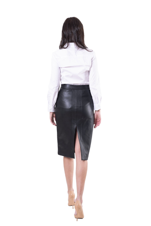 Back view of sexy elegant business woman walking away or leaving. Unrecognizable person. Full body isolated on white background.
