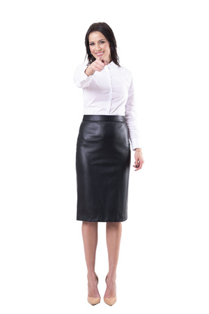 Happy excited business woman smiling and pointing finger at camera choosing you. Full body isolated on white background. Zdjęcie Seryjne