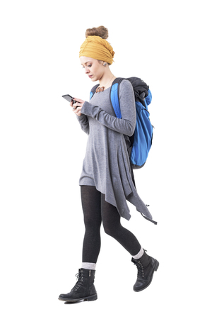 Side view of young woman backpacker tourist searching for places on cellphone app. Full body isolated on white background. Stockfoto - 123065050