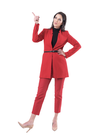 Elegant business sales woman or teacher pointing finger up showing or teaching. Full body isolated on white background.