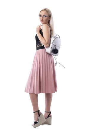 Side view of stylish urban vogue blonde woman with glasses and trendy bag looking at camera. Full body isolated on white background. Stockfoto - 131810531
