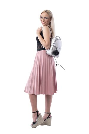 Stylish trendy modern young blond woman posing with silver shiny bag on shoulder. Full body isolated on white background.