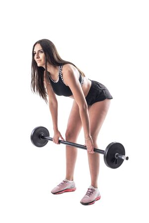 Attractive fit woman brunette in sports clothes doing deadlift with barbell exercises. Full body isolated on white background.