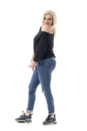 Charming middle age beauty woman posing playfully in casual clothes. Full body length isolated on white background.