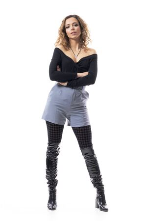 Confident interested curious curly hair young woman in fashionable clothes with crossed arms. Full body length isolated on white background.