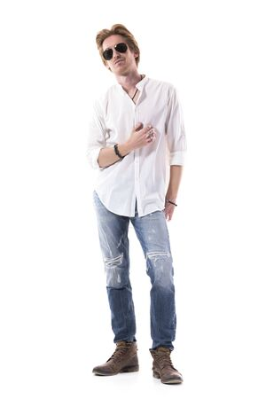 Relaxed happy confident young stylish well dressed man in white shirt and jeans smiling. Full length portrait isolated on white background.