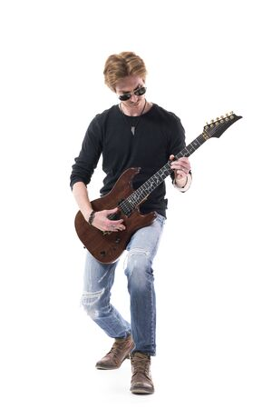 Emotional confident talented young rock musician playing guitar bending backwards. Full length portrait isolated on white background. Stockfoto