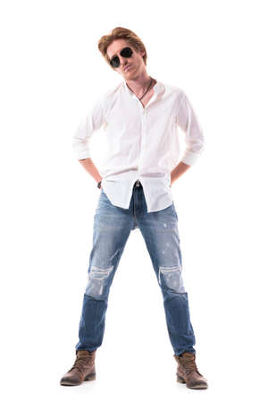 Side view of sad disappointed young casual man looking down with bowed head. Full body length isolated on white background.